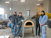 Four Men with Forno Bravo Pizza Oven