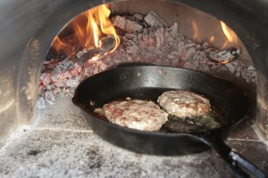 Toss a couple burgers into the Lodge Cast Iron pan.