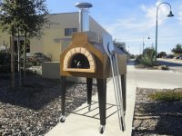 Andiamo70 wood fired pizza oven by Forno Bravo shown on casters with brick entry.