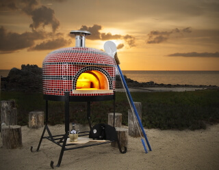 Forno Bravo Napolino Pizza Oven with red and black tile on the beach in California.