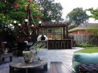 Outdoor wooden furniture - white pompeii pizza oven - metal candle chandelier