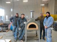 Four Men with Forno Bravo Pizza Oven