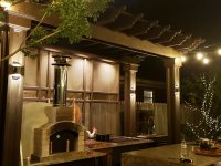 white pompeii pizza oven in outdoor kitchen at night