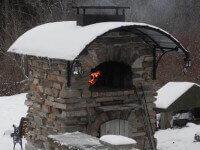 outdoor pizza oven winter snow