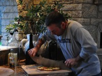 Cutting Pizza with Premio Pizza Oven in Background - Weedville PA