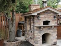 Giardino pizza oven with stone veneer and slate roof