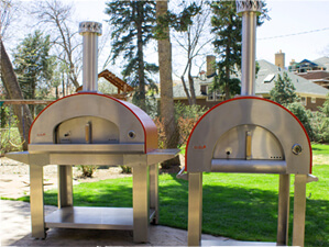 Bella stainless steel wood fired pizza oven in backyard