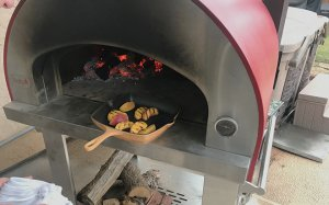 Peaches on grill pan in a Bella Pizza Oven