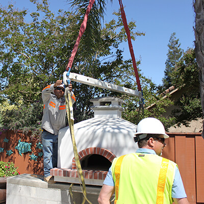 Pizza Oven with Straps and Spreader Bar - Two Men in Safety Vest