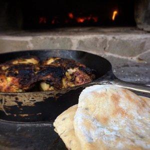 2 pieces naan bread-chicken in cast iron pan