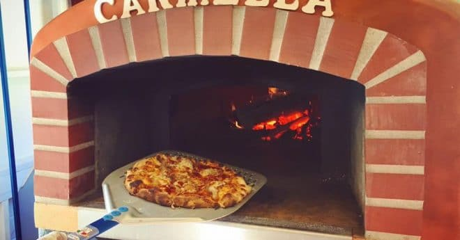 Red Roma Wood Fired Oven with Pizza