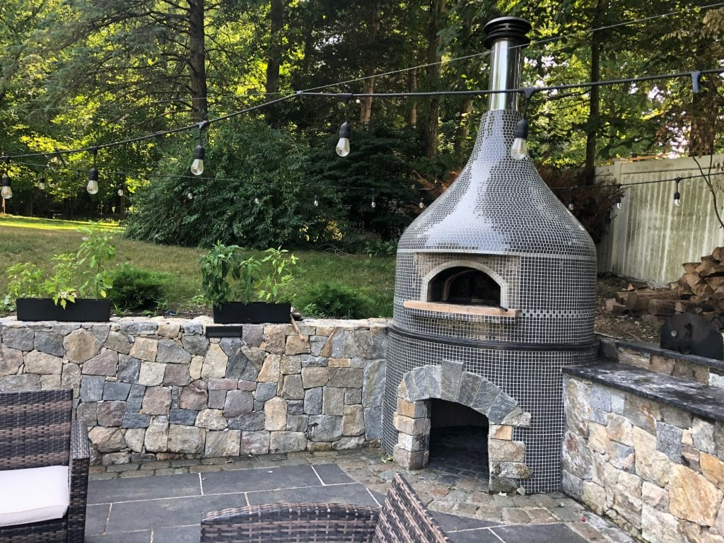 grey tiled volcano style pizza oven