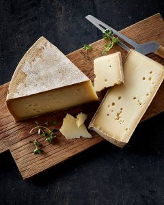 Wedge of white cheese with rind
