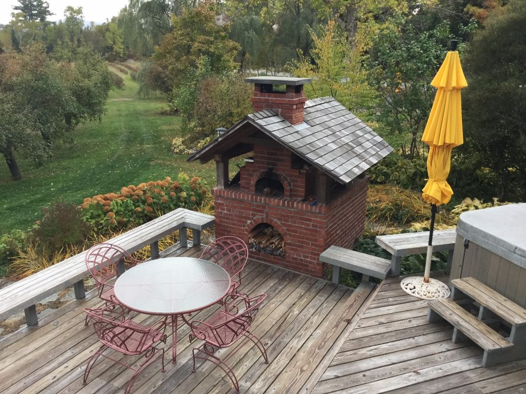 Brick Pizza Oven with roof on an open deck