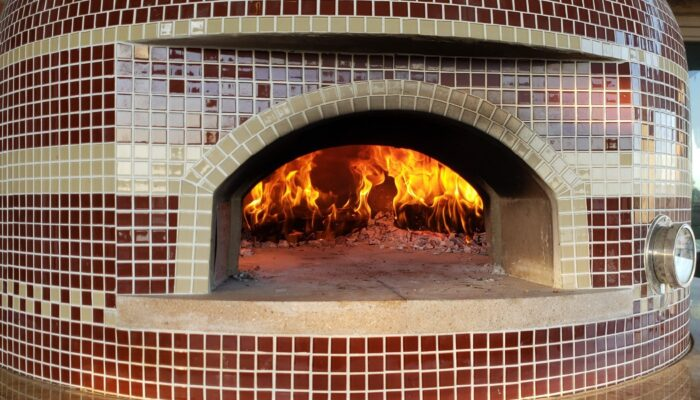 tiled pizza oven with fire