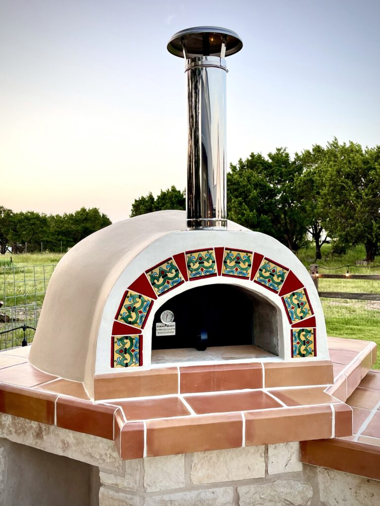 cream stucco oven with tile and terracotta face