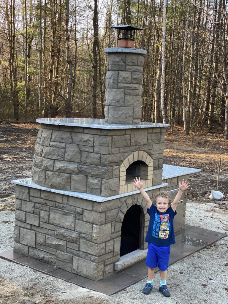 Grey stone Pizza Oven-child with hands in the air