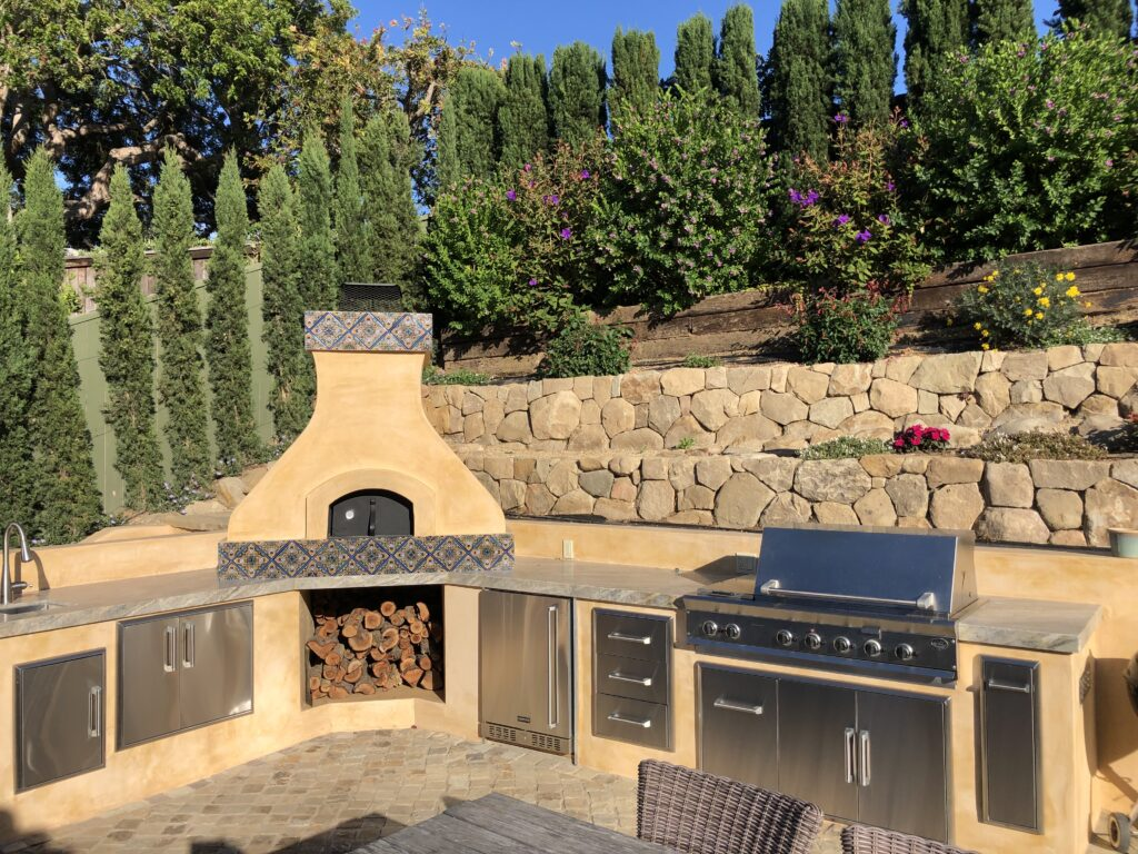 Yellow stucco oven-outdoor kitchen-terraces