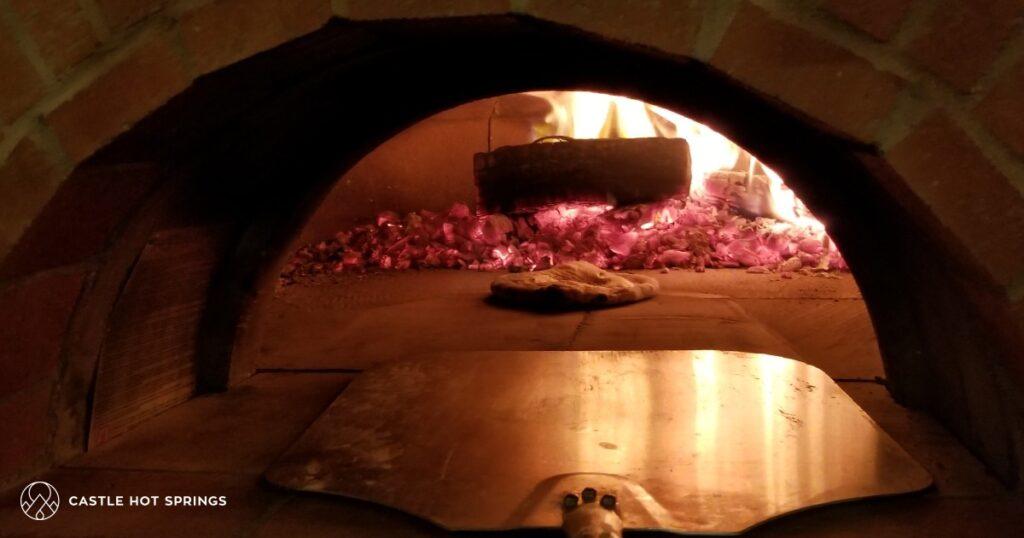 pizza oven interior-coals-pizza-peel