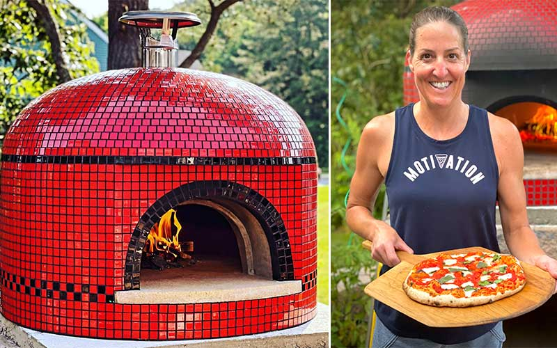 red tiled oven-owner with pizza on peel
