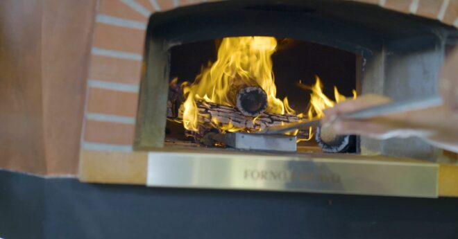 Fire in wood fired pizza oven